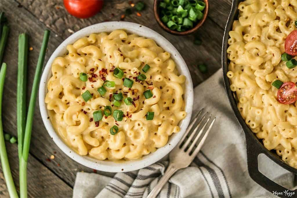 Vegan Mac and Cheese in white bowl topped with green onions.