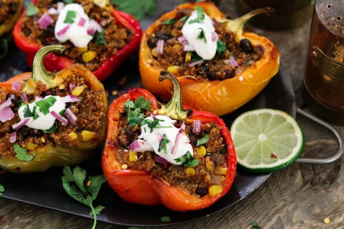 Closeup of red bell pepper stuffed with quinoa.