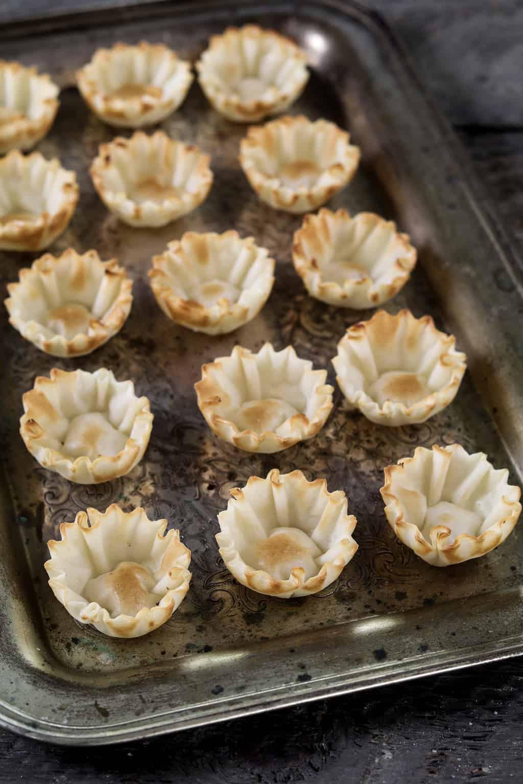 Filo shells on a baking tray.