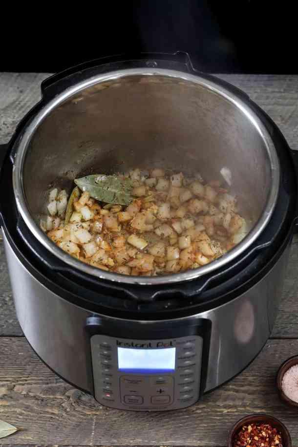 sauteing onions with seasonings to make yellow split pea soup.