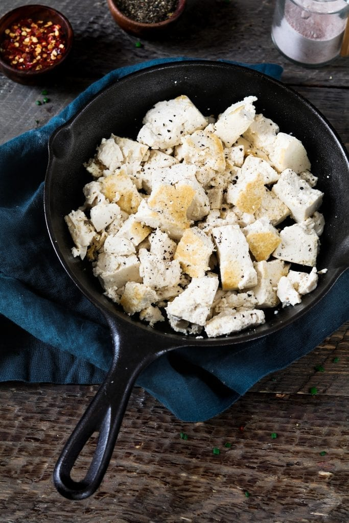 Tofu browned in a cast iron skillet