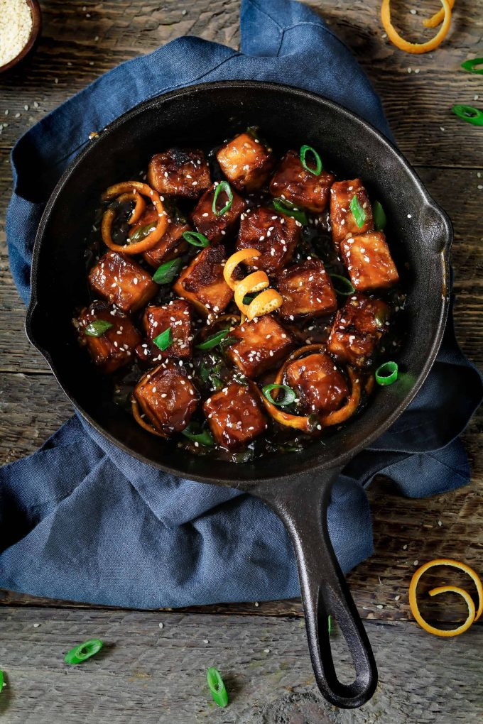 Overhead view of general tsos tofu in a cast iron skillet.