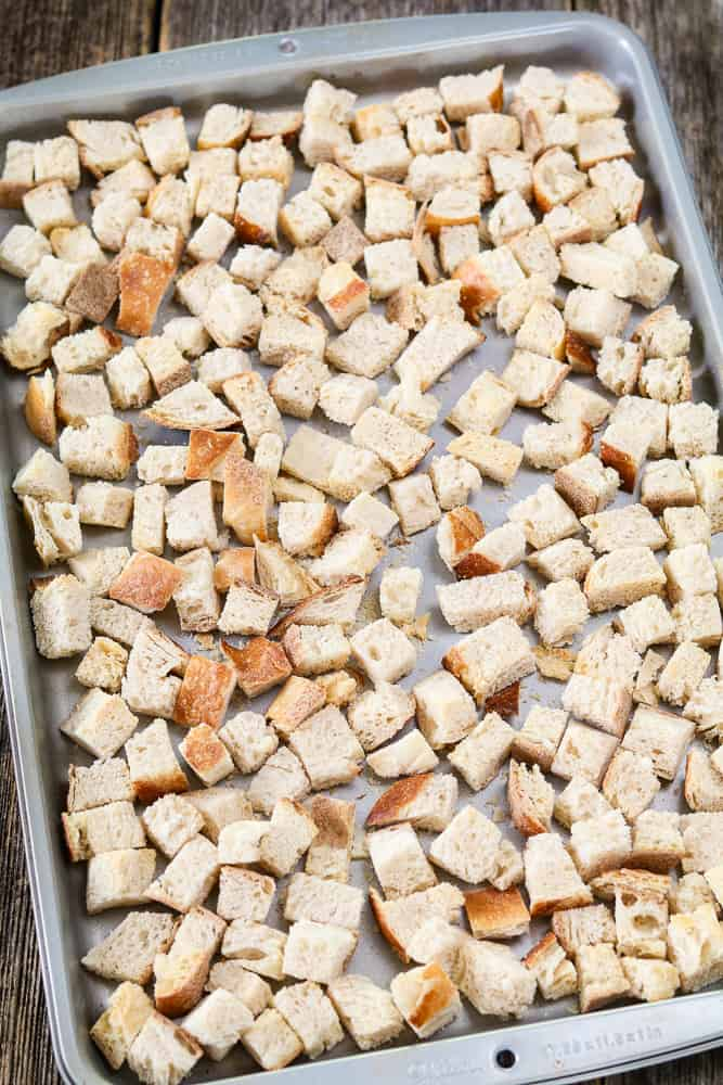 Silver baking tray of toasted bread cubes for Vegan Sourdough Bread Stuffing.