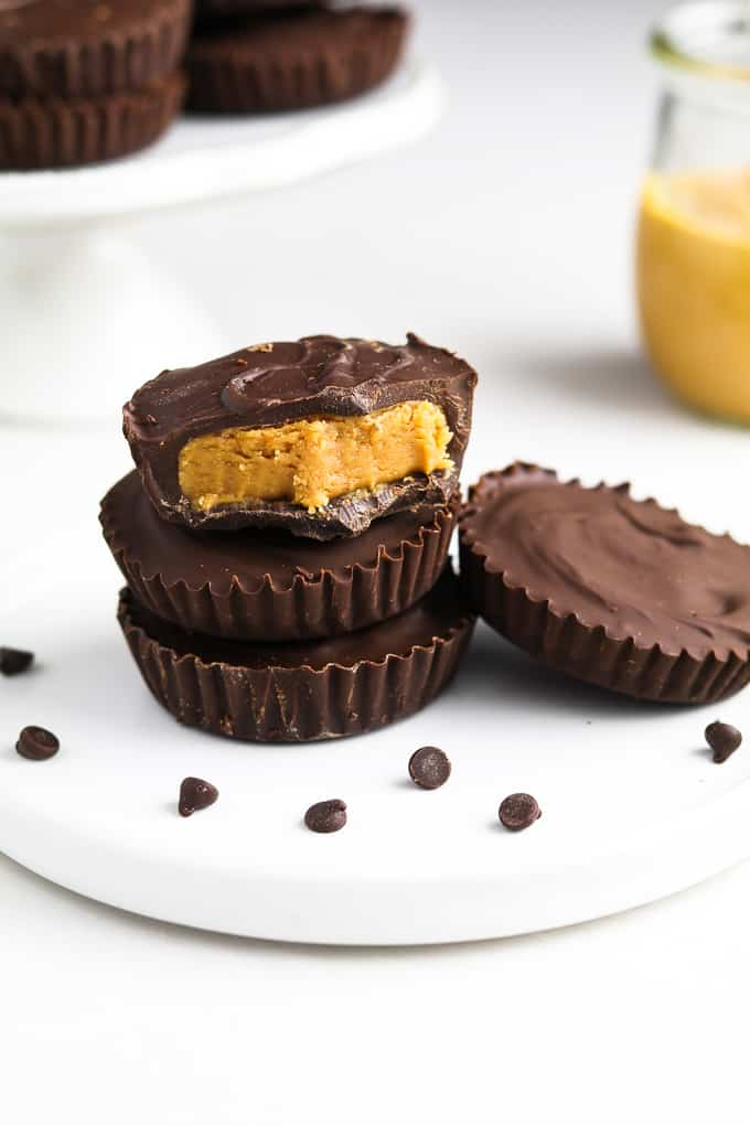 Vegan Peanut Butter Cups on a white plate with chocolate chips on the side.