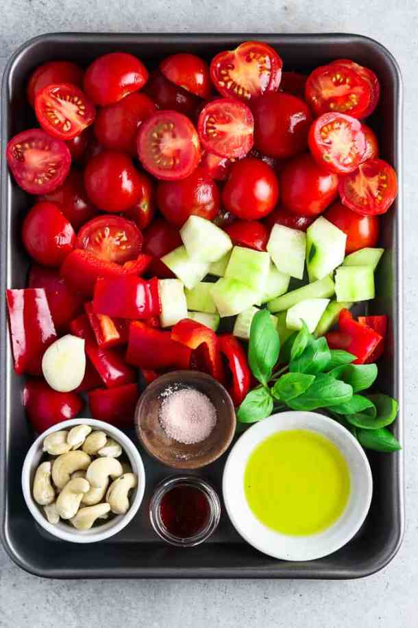 Tray full of fresh ingredients to make an easy gazpacho recipe.