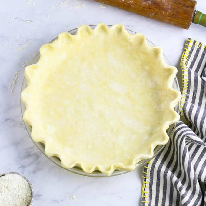 Overhead view of an unbaked pie crust in a pie plate.