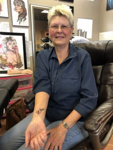 Kris showing off her tattoo