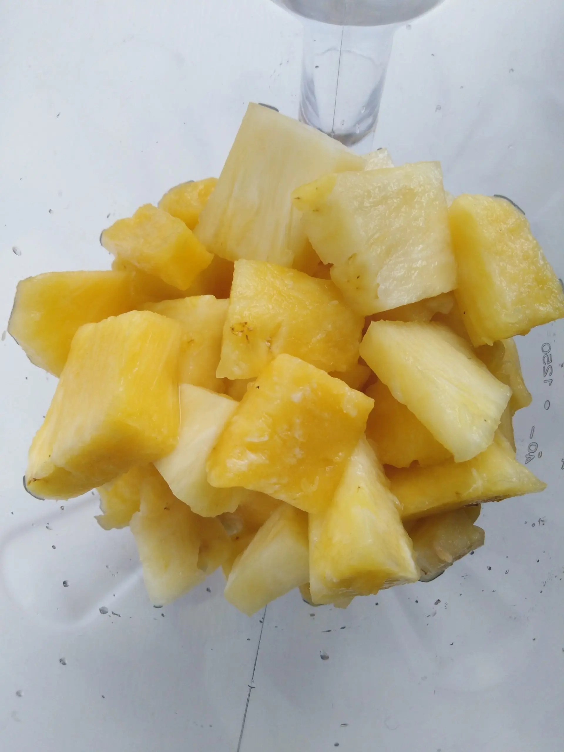 cubed pineapple inside a blender