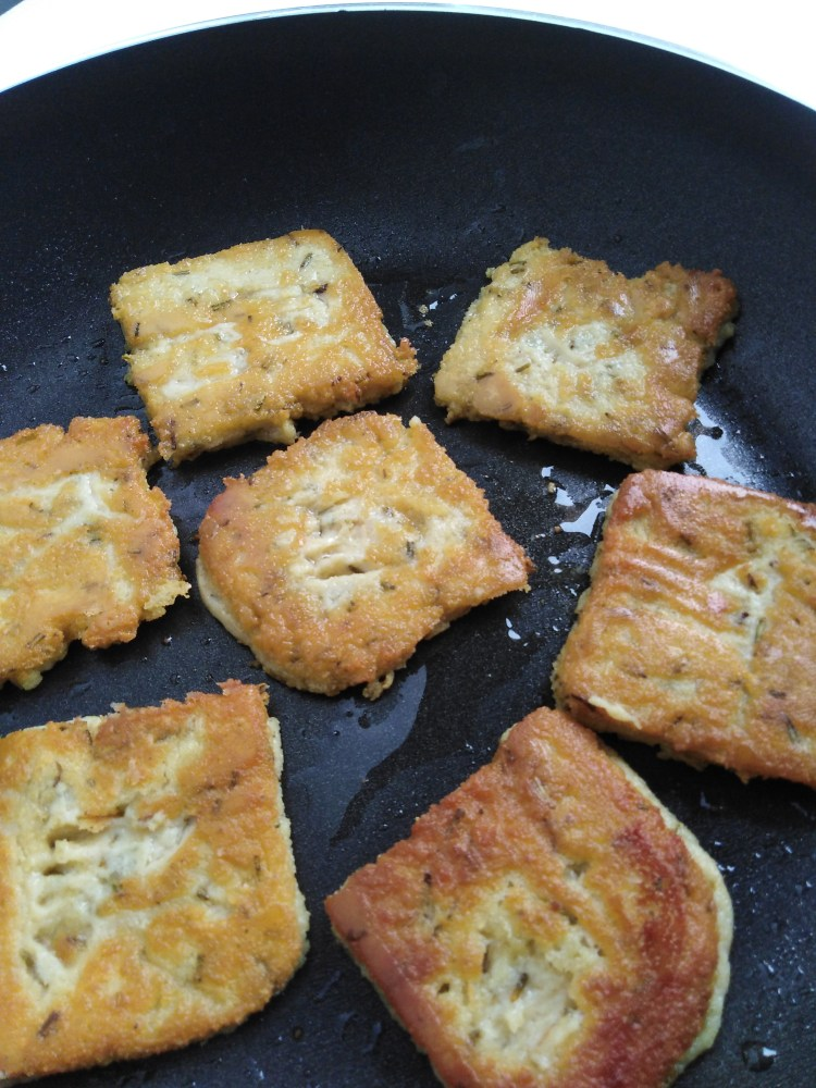 chickpea fritters in a pan being fried