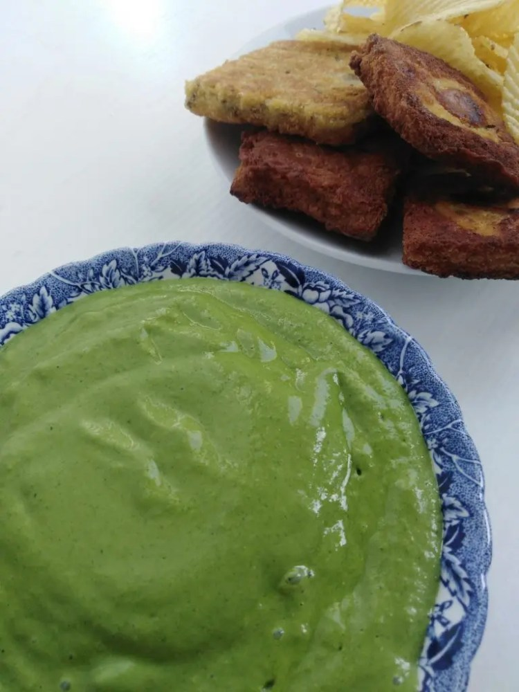 Bowl with Vegan Celery Sauce and Chickpea Fritters in the background