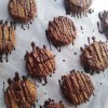 vegan coconut macaroons drizzled with chocolate on rack