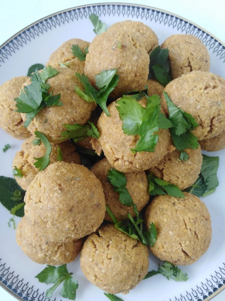 top view of a plate with chickpea balls with chopped parsley on top
