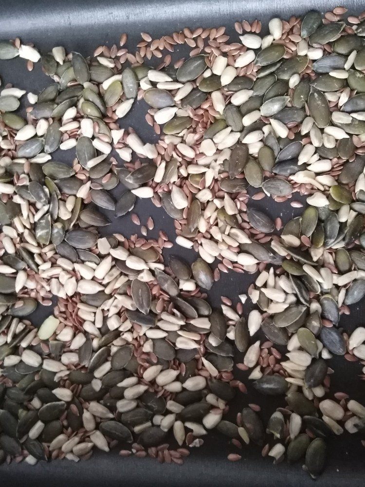 mixed seeds in a baking tray