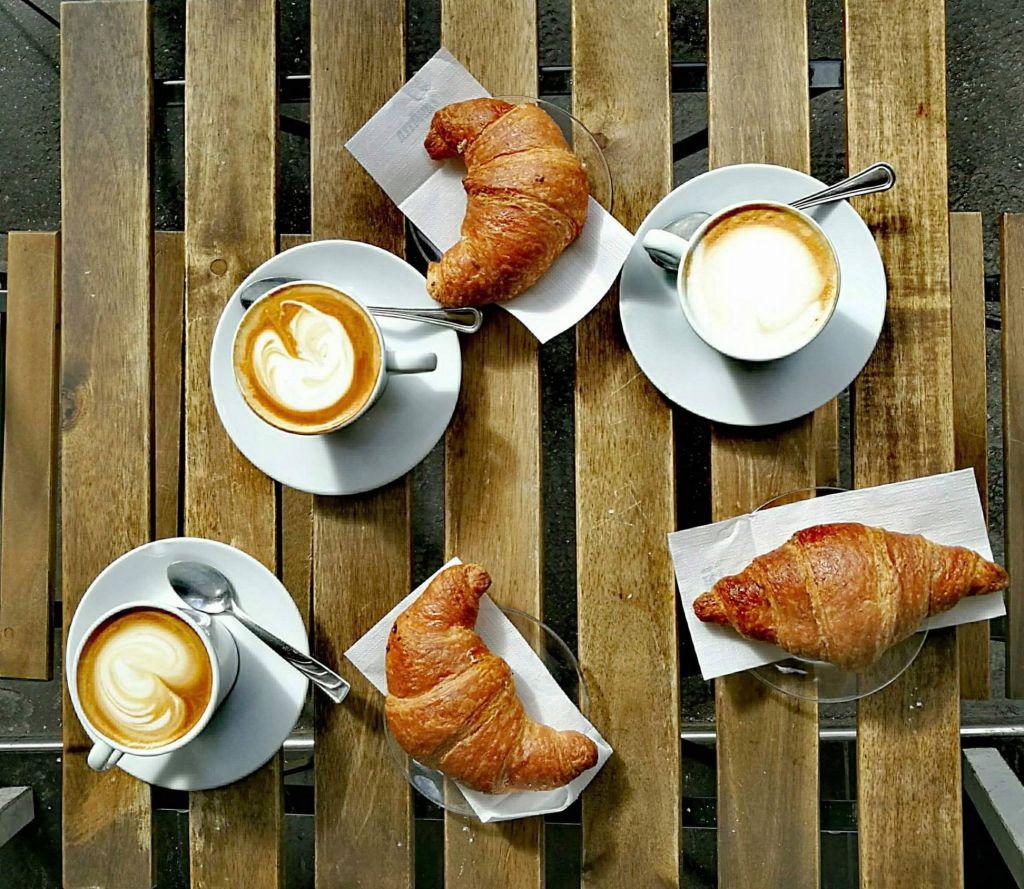 Italian breakfast of three vegan cornetto and three cappuccino