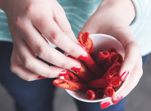 woman picking vegan Takis chips
