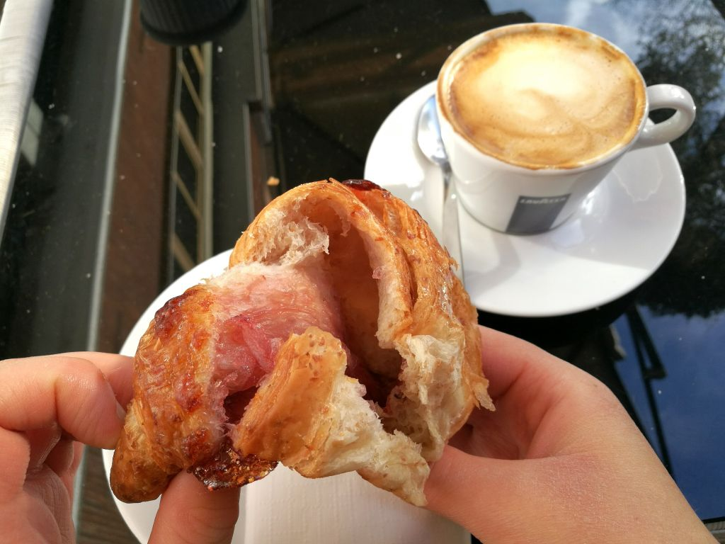 A vegan Italian croissant and cappuccino