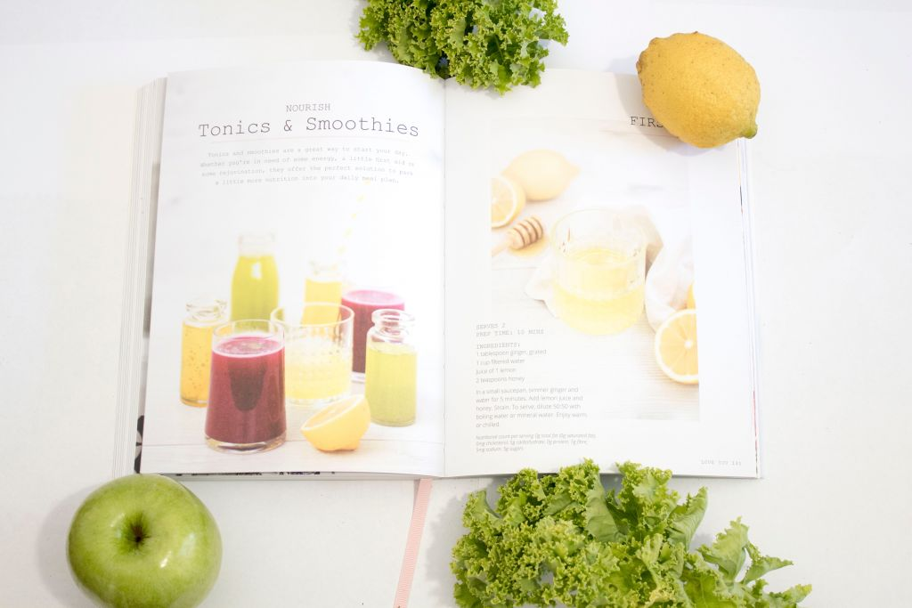 best apple juicer - book on table with fruit