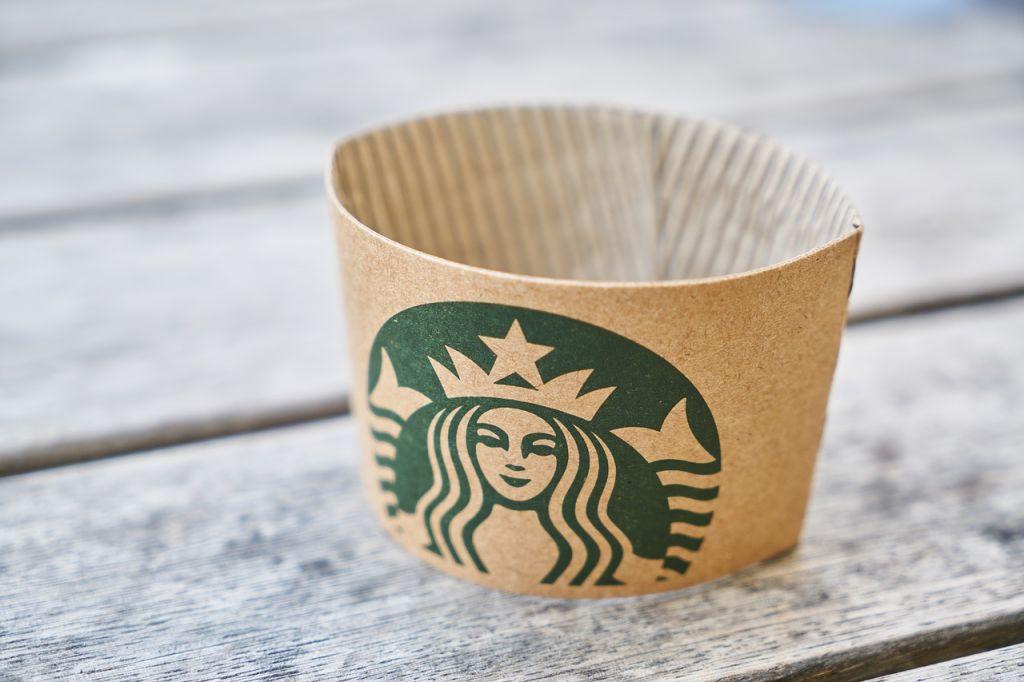 Starbucks cup holder on table
