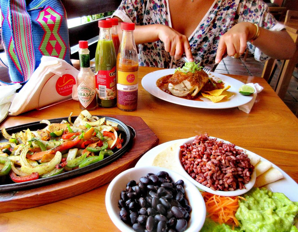 table with vegan tacos and burritos
