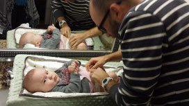 Matt changing his first baby diaper (only wet)! Not sure if Andrew approves.