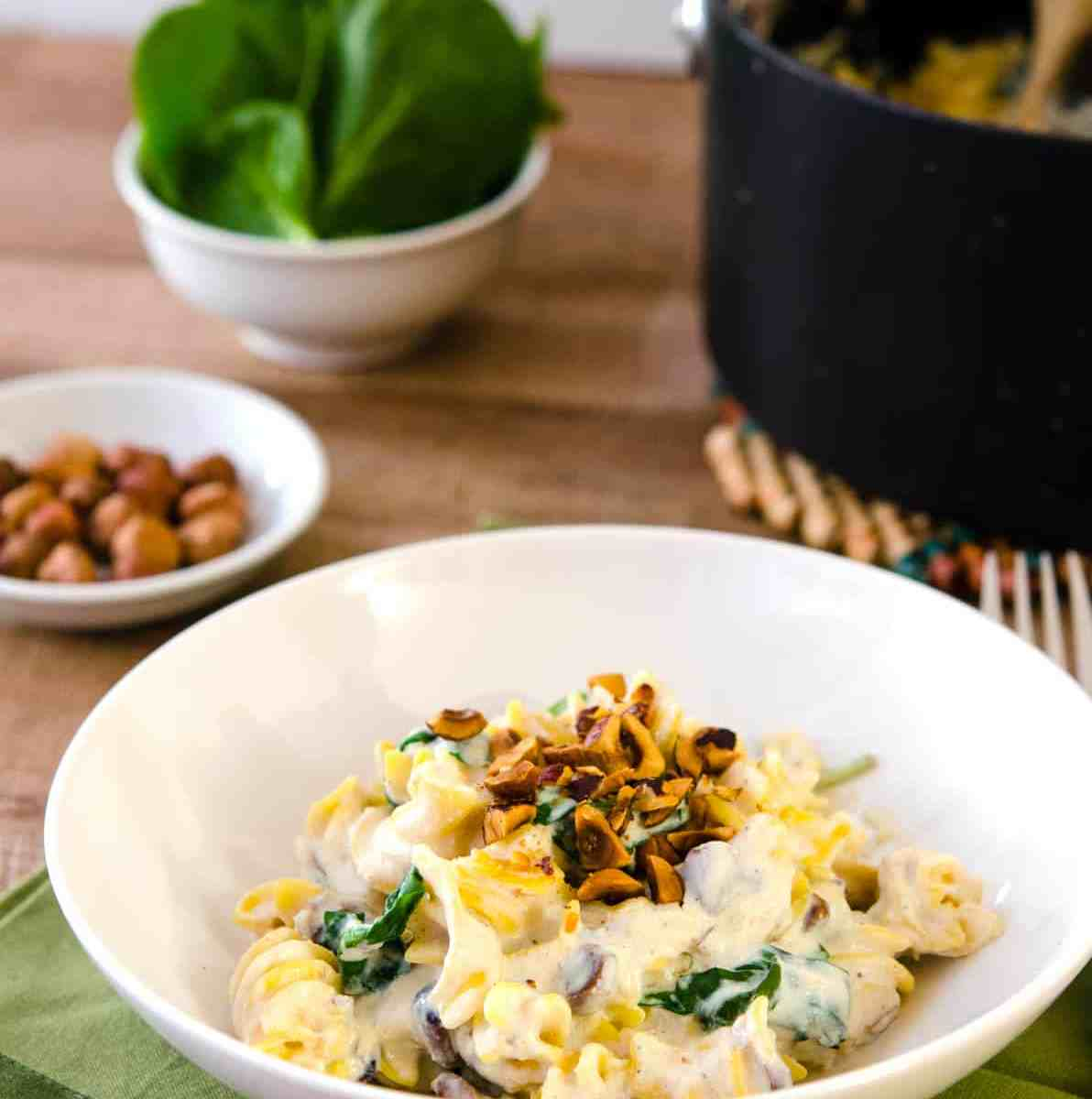 A low-fat, creamy garlic sauce over quinoa pasta, dotted with toasted hazelnuts. This delicious entree is impressive AND delicious!