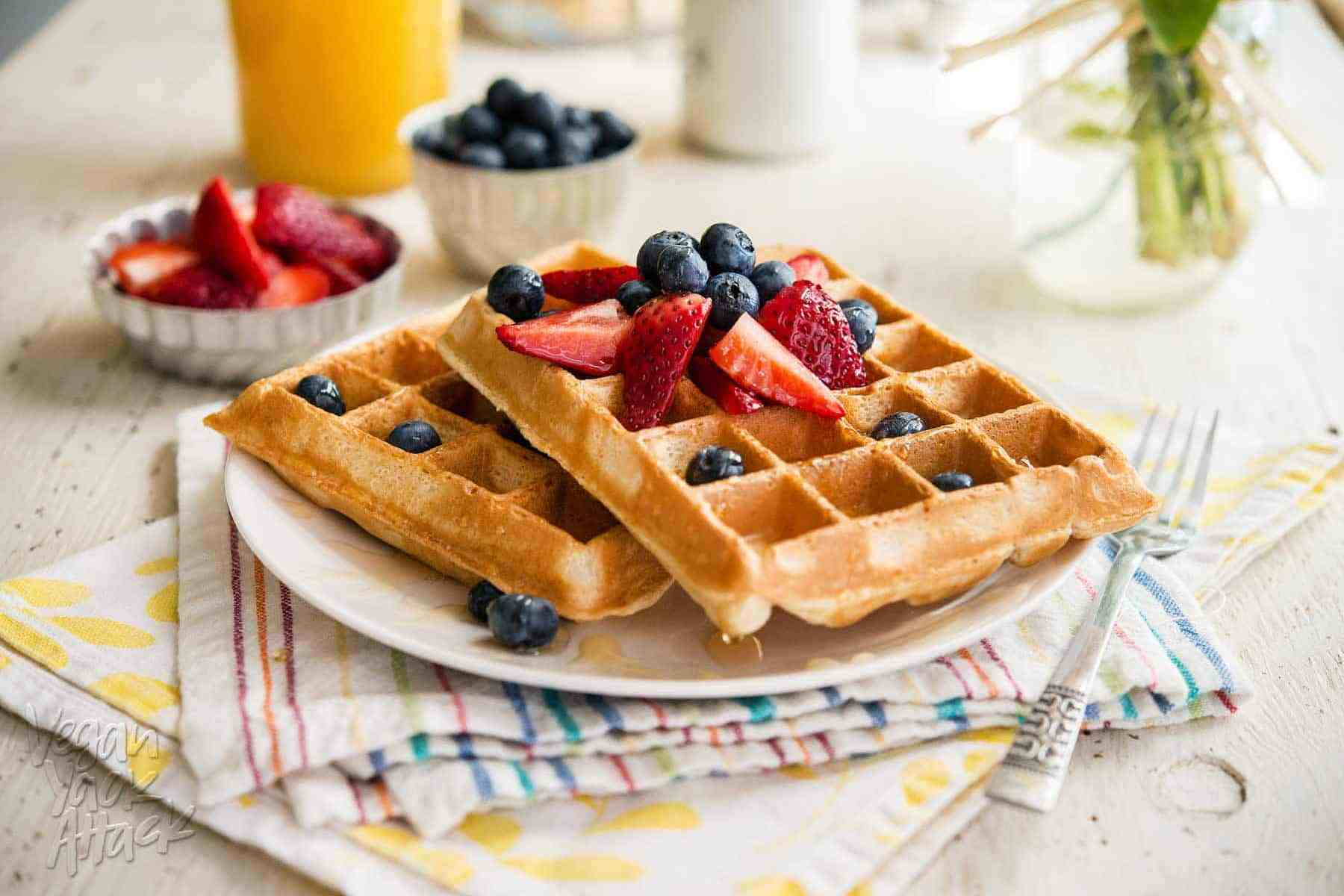 These Berry Pineapple Belgian Waffles are subtly tropical and topped with fresh berries, plus they come together in minutes!