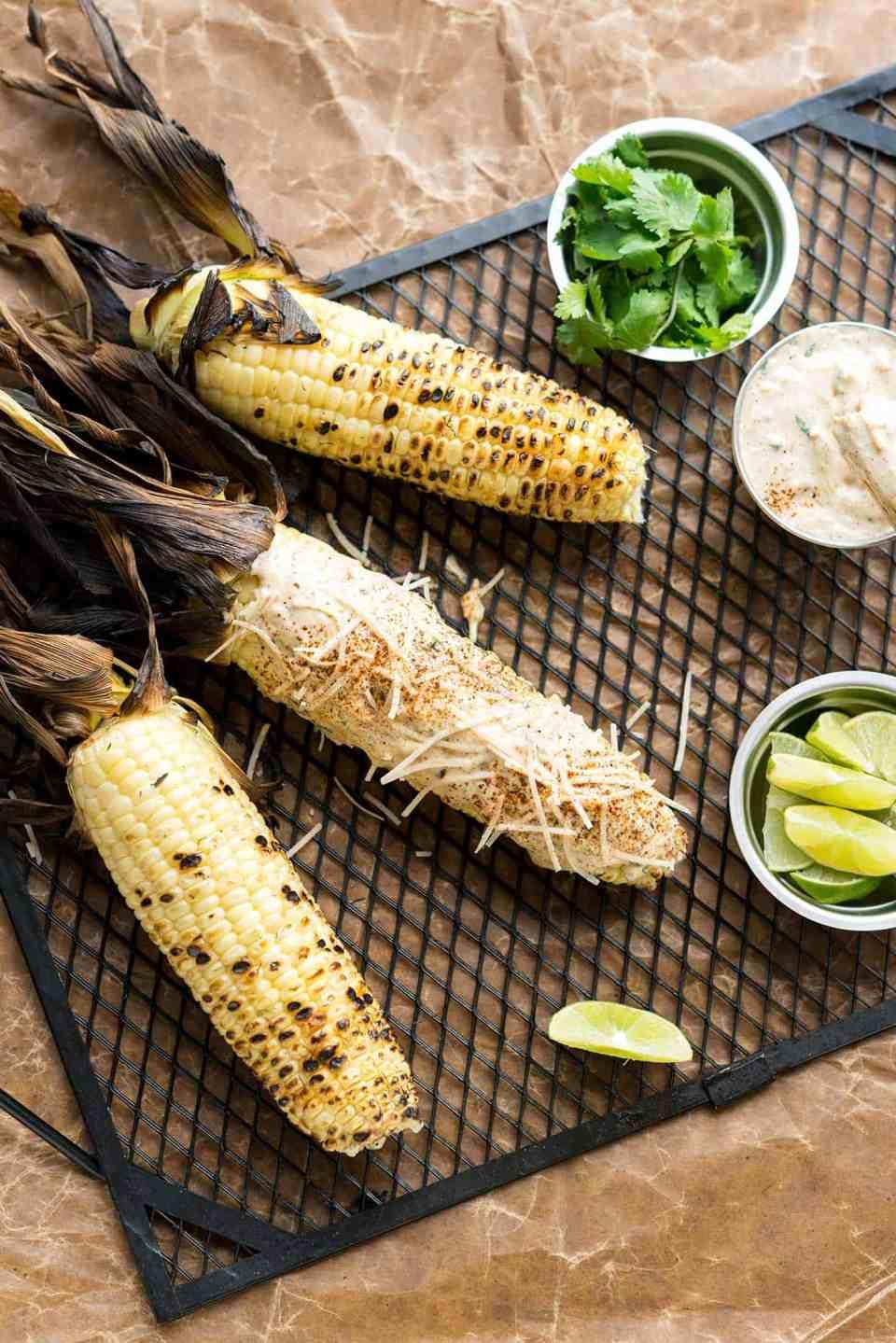 Street Fair Corn from the NYC Vegan Cookbook! Grilled corn slathered in a creamy sauce, vegan parmesan and lime juice. Yum! #glutenfree #dairyfree #vegan