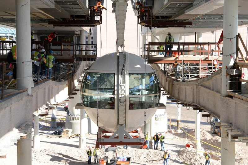 Technical precision and detailed planning go into attaching the first passenger cabin to the rim of the Las Vegas High Roller observation wheel.