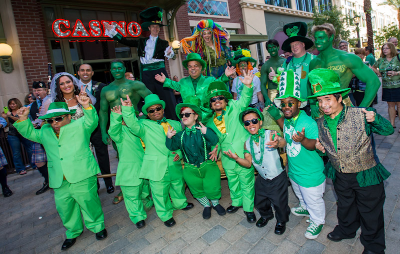"Gathered at the entrance of O'Sheas Casino, Brian ""Lucky"" Thomas, Joe Greene and Jennifer Michaelson, a troop of leprechauns, stilt walkers, balloon artists, green hunks and bag pipers, kicked-off O'Sheas St. Patty's Day Block Party."