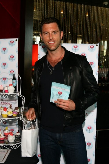 Michael Lomenda poses with Beauty Kitchen goodies while at GBK 2014 Espy Awards Party