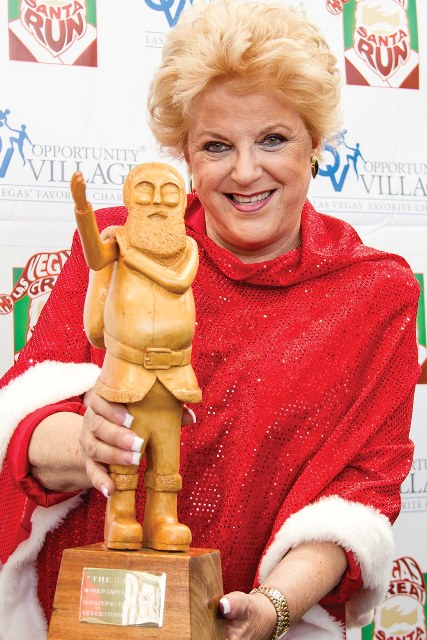 Mayor Carolyn Goodman Holds the  World Santa Run Trophy at GSR Media Preview