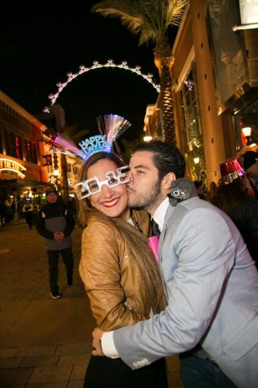 A couple celebrates New Year's Eve 2015 at The LINQ Promenade and High Roller.