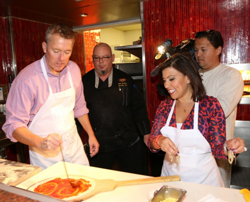 John Huck and Olivia Fierro with TREVI Executive Chef Peter Scaturro, middle, creating a pizza
