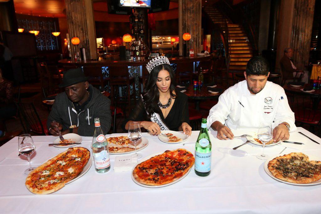 Judges Sean E. Cooper, Brittany McGowan and Chef Jose Navarro taste competitor's pizza