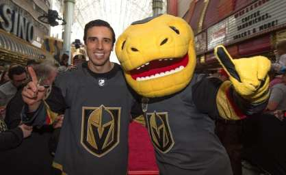 Goaltender Marc-André Fleury Poses with Team Mascot, Chance, While Celebrating at Fan Fest