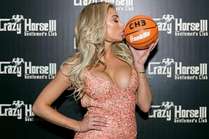 Khloe Terae kissing Crazy Horse III basketball