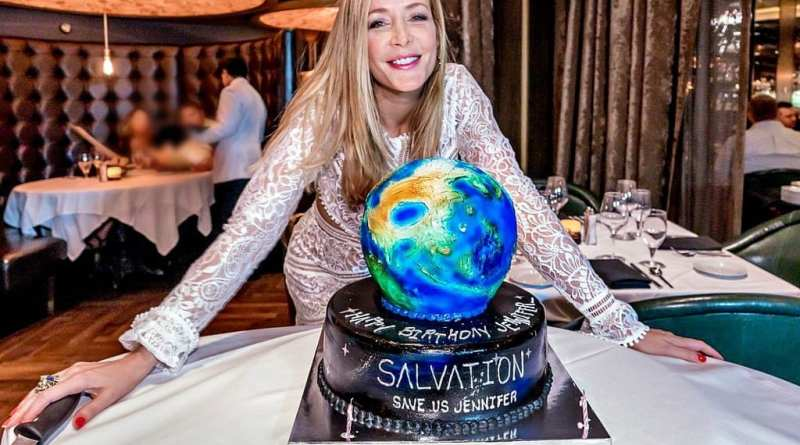 Jennifer Finnigan from the hit television series Salvation poses with her birthday cake.