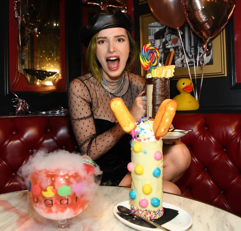 Bella Thorne enjoys the Watermelon Patch Goblet, Insane Caramel Sugar Daddy Cheesecake milkshake, and Twinkie Dinkie Insane Milkshake