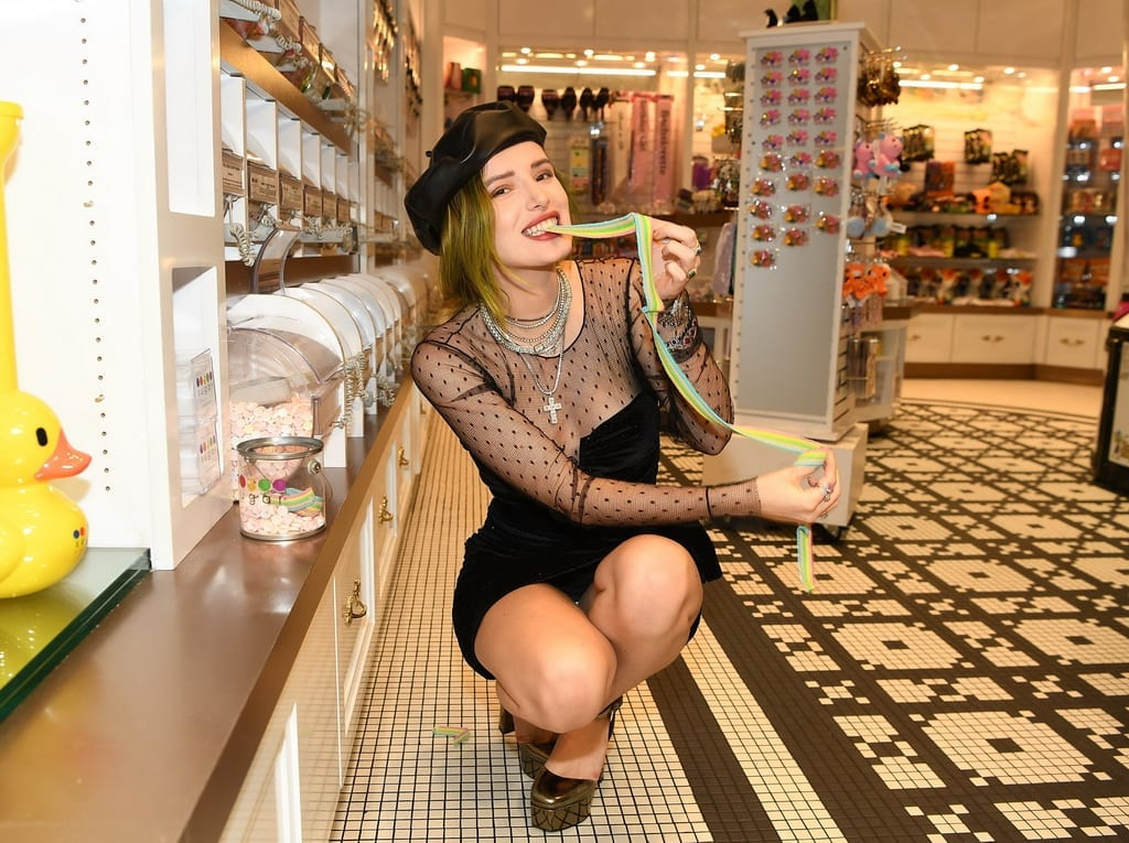 Bella Thorne satisfies her sweet tooth with sour rainbow belt