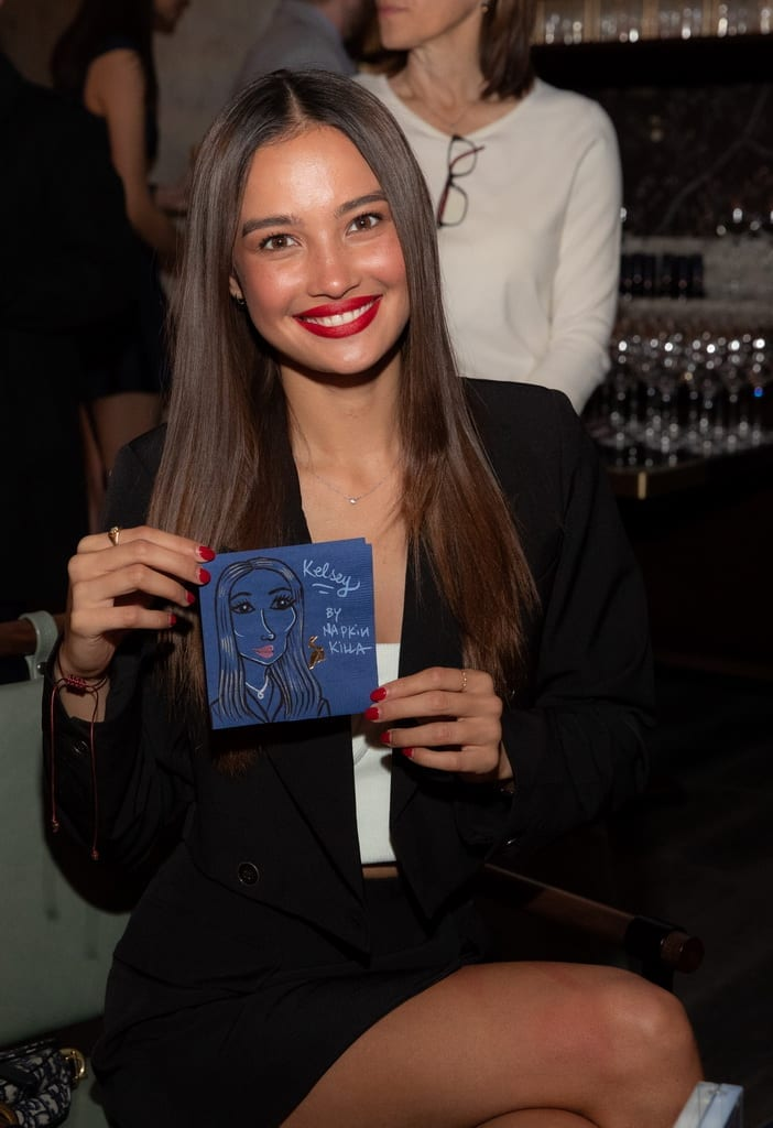 Kelsey Merritt with a custom drawing by Napkin Killa at the Mott 32 grand opening celebration at The Venetian Resort Las Vegas, 12.28.18_Credit Erik Kabik