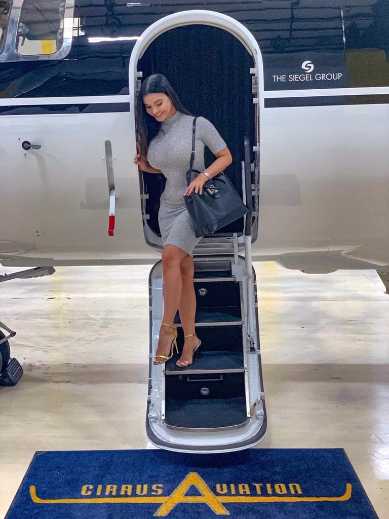 Mayra Veronica steps off the Hawker 800XPi at the Cirrus Aviation Hangar located in Las Vegas
