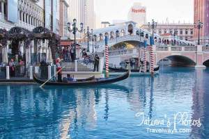 Canal Grande at Venetian Hotel in Las Vegas, with the view of Rialto Bridge and Harras Hotel in the background