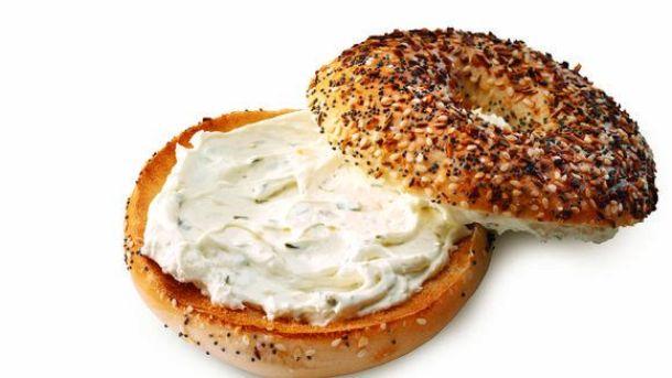 Einstein Bros. bagel with shmear, free bagel
