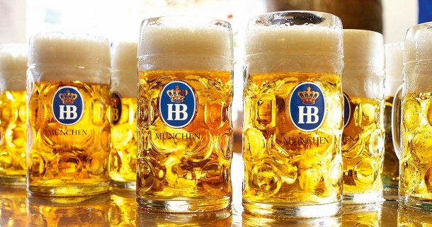 Hofbrauhaus beer steins filled with golden beer