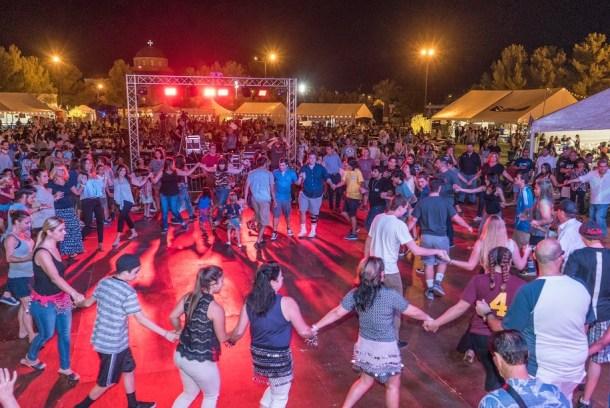 Greek dancing in a circle in large crowd at the Las Vegas Greek Food Fesitival