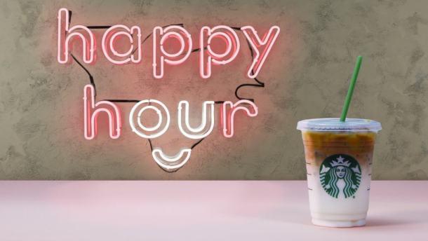 Starbucks happy hour BOGO iced beverage with neon sign