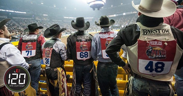 National Finals Rodeo cowboy contestants watching rodeo