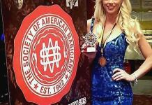 Chloe Crawford receives Assistant of the Year Award from Society of American Magicians