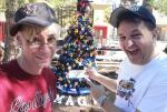 """Murray SawChuck and Douglas """"Lefty"""" Leferovich with Christmas tree at Opportunity Village"""