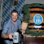 Mark Shunock poses with the mallet and mug of beer at Hofbräuhaus Las Vegas